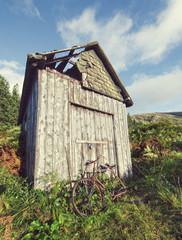 rusty bike and shack