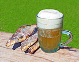 Mug of beer and fish in the open air