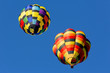 hot air balloons against blue sky