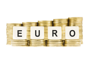 Word EURO (European Currency) on Gold Coin Stacks Isolated White