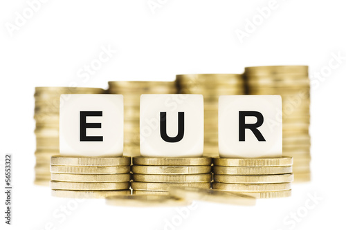 EUR (Euro Currency) on Gold Coin Stacks Isolated on White
