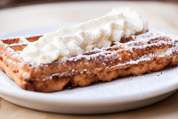 Belgian Waffle with whipped cream on a plate