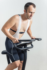 Man exercising on stationary bike