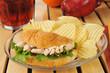 Chicken croissant sandwich with fresh fruit