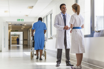 Doctors Hospital Corridor Nurse Pushing Wheelchair