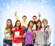 A group of happy teenagers on a snowy background