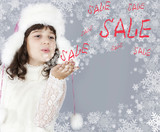 winter sale cute girl blow to snowflakes