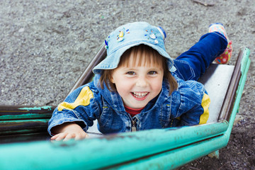 Cheerful little kid playing