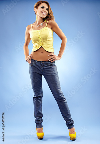 Attractive female in jeans and top