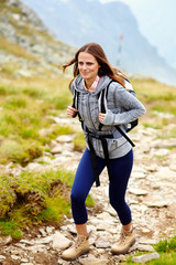 Woman hiker on a mountain trail