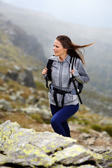 Woman hiker climbing