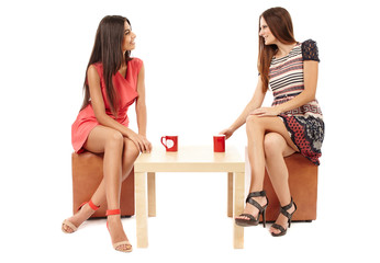 Girlfriends talking over a cup of tea