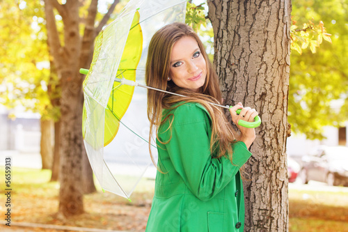 Pretty girl with transparent umbrella