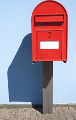 red postbox letterbox on the street