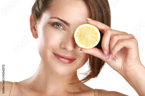 Woman beauty concept with fruits slices over eyes