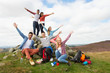 Group Of Young People Hiking In Countryside - 56563566