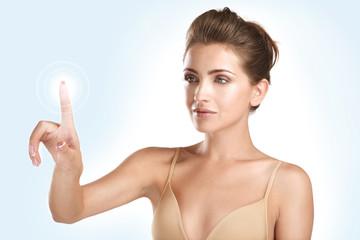 young beautiful model touching a futuristic screen panel