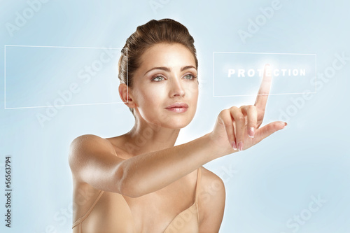 young beautiful model touching a futuristic screen panel