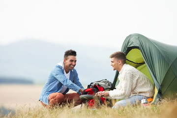 Two Young Men On Camping Trip In Countryside