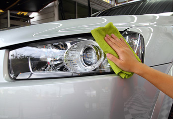 Hand with a wipe the car polishing