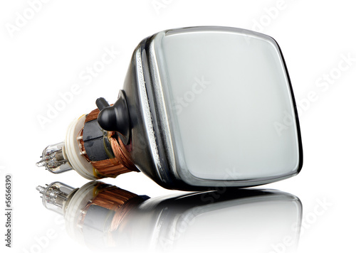 Old television tube on glass, white background