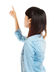 Asian woman pointing backward