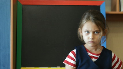 dissatisfied with the schoolgirl near blackboard