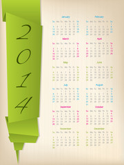 2014 calendar with green origami arrow