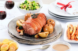 Christmas pork roast dinner with sides and wine