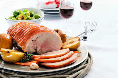 Traditional christmas table setting with pork roast