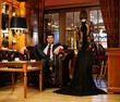 Elegant couple in formal dress in luxury cabinet