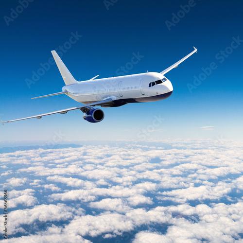Leinwanddruck Bild Airplane in the sky - Passenger Airliner / aircraft