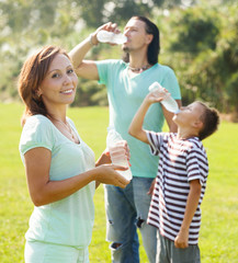 ordinary  couple with teenager drinking water