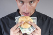 businessman is eating a sandwich with money