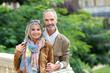 Senior couple standing on bridge