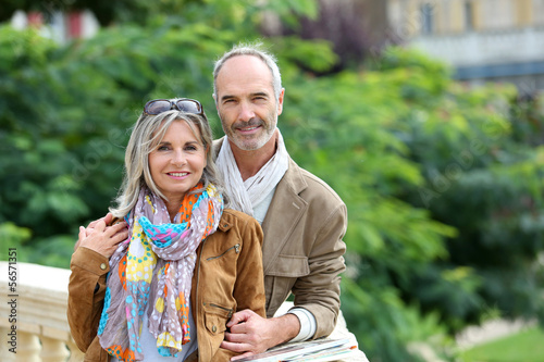 Senior couple standing on bridge
