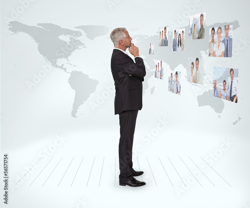 Mature businessman staring at futuristic interface