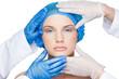 Surgeons examining content blonde wearing blue surgical cap