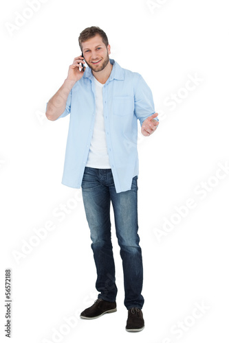 Relaxed man posing while having a call