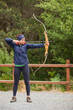Brunette practicing archery