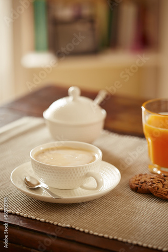 Breakfast table with juice, coffe and cookies