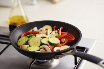 Preparing vegetables in a pan