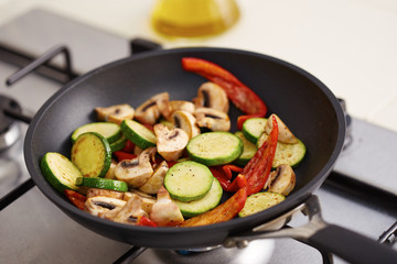 Preparing grilled vegetables in a pan