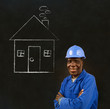 African black man worker with chalk house on a background
