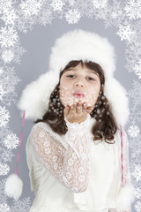 cute girl white dressing blow snowflakes winter