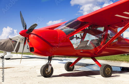 Red two-seater mini plane