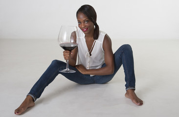 Black woman tasting red wine  large glass