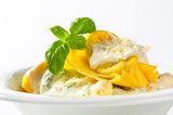 Ricotta and spinach tortelloni with cream sauce and Parmesan