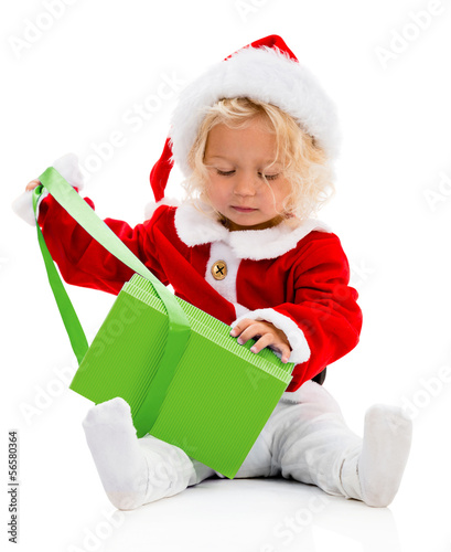 Girl opening a Christmas gift
