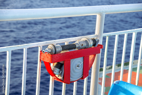 Fire extinguishing pipe with sea background on a cruise ship